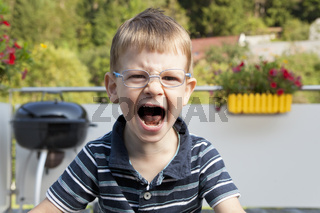 Crying boy on terrace