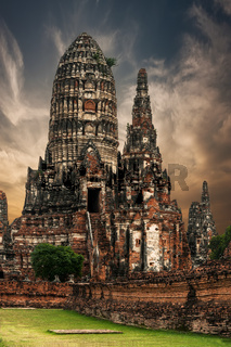 Ancient Buddhist pagoda ruins at Chai Watthanaram temple under sunset sky. Ayutthaya, Thailand travel landscape and destinations