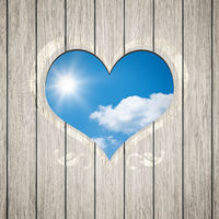 wooden heart with the blue sky
