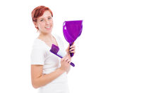 happy woman with brush and shovel