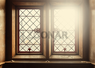Old windows with lens flare