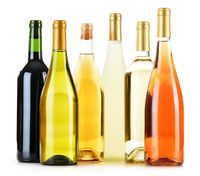 Composition with variety of wine bottles isolated on white
