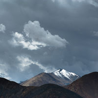 Himalaya high mountain landscape panorama with dramatic cloudy sky near Khardung La pass. India, Ladakh, Altitude 5600 m