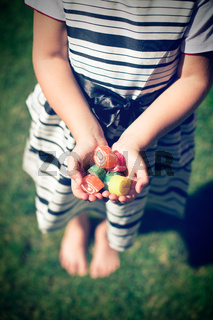 Little girl with candy in hands