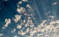 Sky daylight. Natural sky composition. Element of design. Blue sky with clouds and sun rays