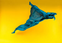 blue fabric over yellow background
