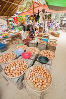 People selling eggs at asian market. Bagan, Myanmar