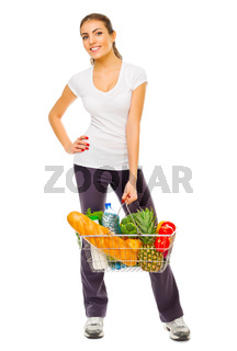 Young girl with full shop basket isolated
