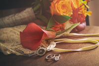Wedding rings and accessories on chair