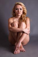 Blonde woman sitting naked