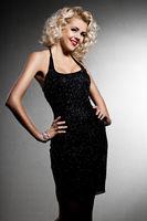 smiling blonde woman in black dress