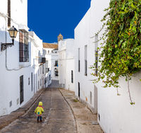 Baby walking on narrow street of Vejer de la Frontera. Costa de la Luz, Spain