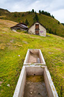 Trough and old building, Riederalp, Switzerland