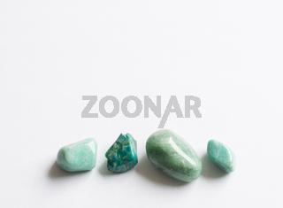 Four green semi-precious stones