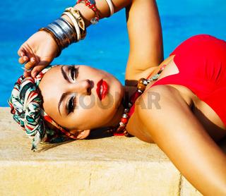 Beautiful fashionable woman near the pool