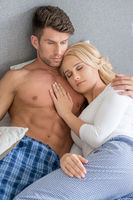 Romantic Lovers on Bed Fashion Shoot