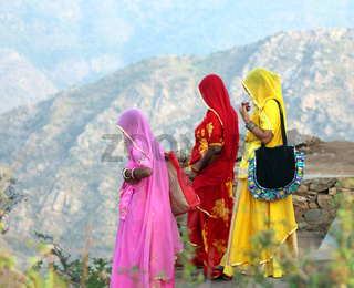 Indian women in colorful saris on top of hill