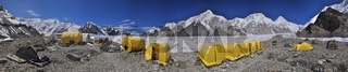 Scenic panorama of tents on Engilchek glacier in picturesque Tian Shan mountain range in Kyrgyzstan