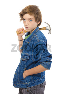 confident teenage boy holding a hammer on his shoulder, isolated on white