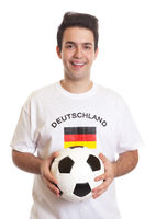 Laughing german soccer fan with football