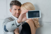 Young Sweet Couple Taking Self Photos