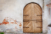 Wooden door in an old style. Courtyard of old castle