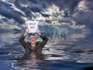 Senior man holding help me paperwork in water