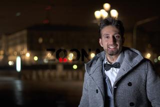 Attractive young man at night in Piazza Vittorio Veneto in Turin