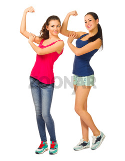 Two young sporty smiling girls isolated
