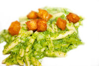 Fresh handmade pasta with pesto and croutons