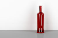 Red alcohol bottle
