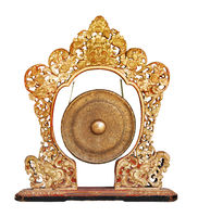 Traditional balinese gong - musical instrument isolated on white background. Indonesia, Bali Island