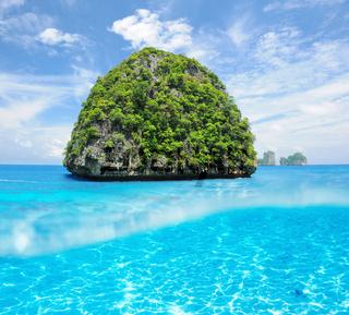 Uninhabited island with white sand bottom underwater view