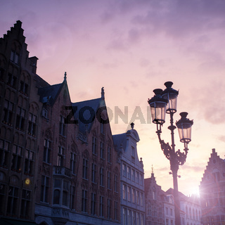 Silhouettes of city center houses in Bruges against beautiful sunset, Belgium