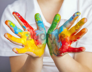 hands painted  in colorful paints