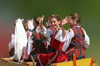 Group of yong women in bulgarian folk costumes