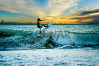 Athletic surfer with board