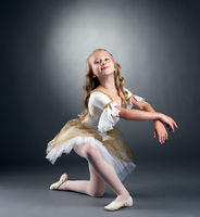 Image of nice little ballerina posing at camera