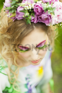 Woman with tulips, lily of the valley and pink peony in her hair