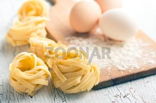 Italian pasta tagliatelle, eggs and flour