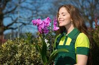 Florist or gardener smelling at flower