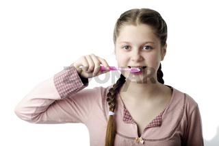 Cute girl brushing teeth isolated on white
