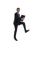 Jumping businessman with briefcase