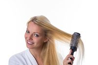 Blonde with hairbrush in her hand