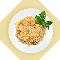 Dish of fried rice with meat(pilaf) on white plate