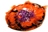 Sliced marinated salmon on a plate