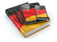 German learning. Mobile devices, smartphone, tablet pc and book .
