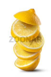 Falling slices of lemon isolated on white background