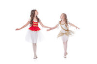 Two cute young ballerinas looking at each other