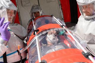 HAZMAT team with patient on stretcher